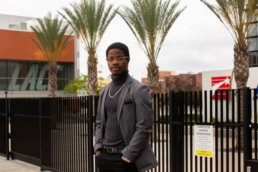 Stevie Carpenter, a graduate of Los Angeles City College, stands in front of the closed campus