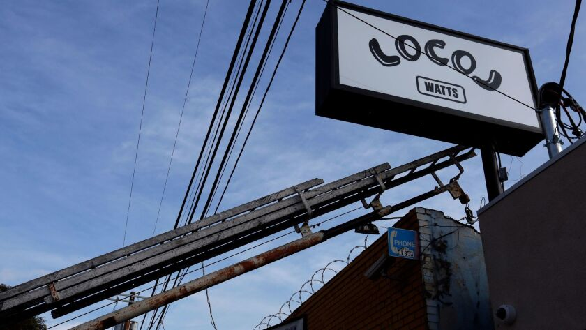 A sign for LocoL, a Watts fast-food restaurant by chefs Roy Choi and Daniel Patterson.