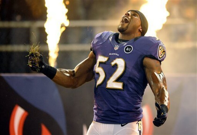 FILE - In this Sept. 23, 2012, file photo, Baltimore Ravens linebacker Ray Lewis reacts as he is introduced before an NFL football game against the New England Patriots in Baltimore.  Ravens fans will rock the building during Ray Lewis' pregame Squirrel Dance, a YouTube sensation that Lewis will pe