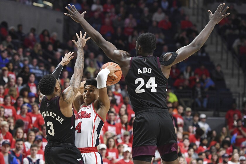Mississippi State guard D.J. Stewart Jr. (3) and forward Abdul Ado (24) guard Mississippi guard Breein Tyree (4) during the second half of an NCAA college basketball game in Oxford, Miss., Tuesday, Feb. 11, 2020. Mississippi won 83-58. (AP Photo/Thomas Graning)