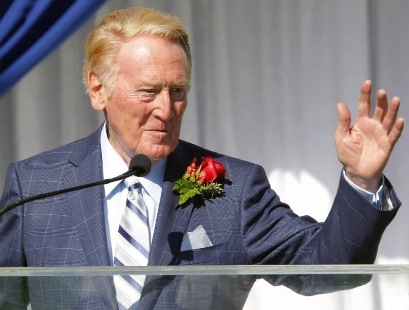 Hall of Fame broadcaster Vin Scully is introduced on Thursday as the grand marshal for the 125th Tournament of Roses parade.