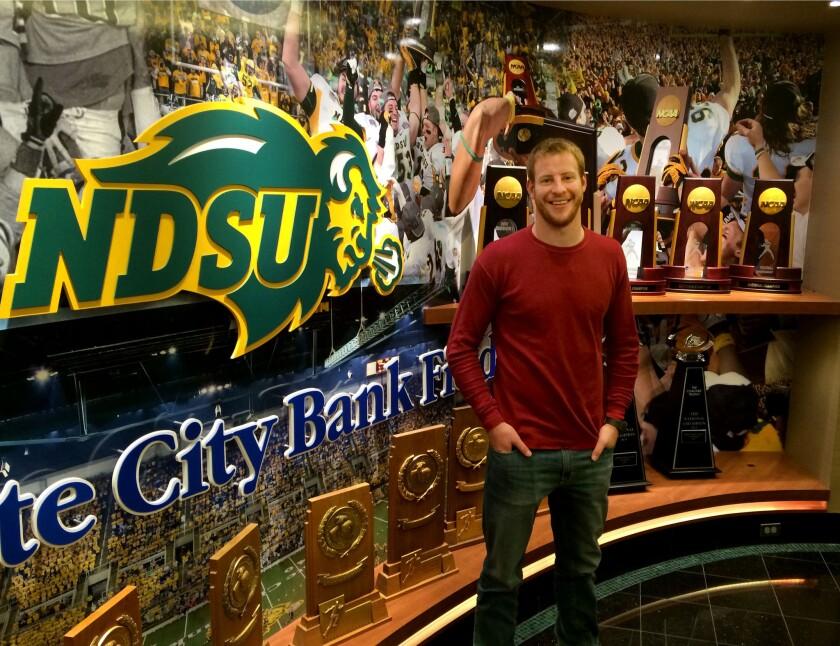 North Dakota State's quarterback Carson Wentz is seen in front of a trophy case inside the Fargodome in Fargo, North Dakota.