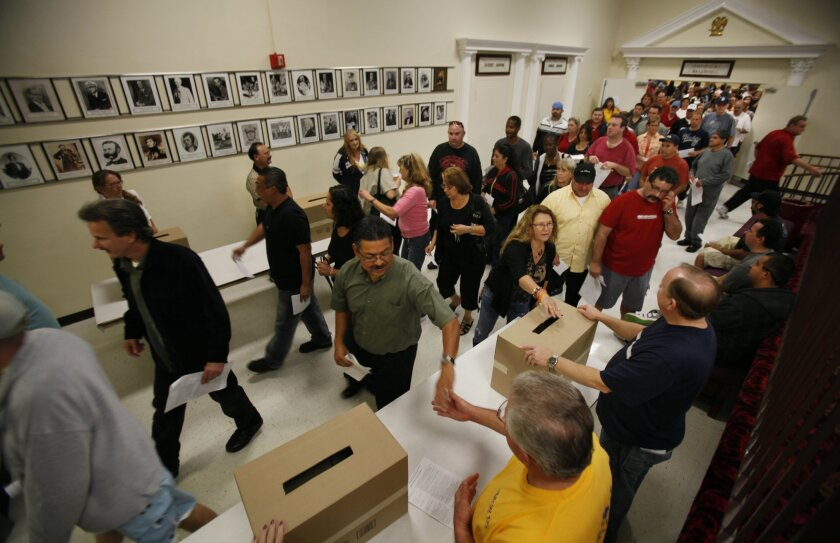 Grocery workers voted on proposed contract ratification Friday morning at the Scottish Rite Temple in Mission Valley. / Photo by Peggy Peattie, U-T