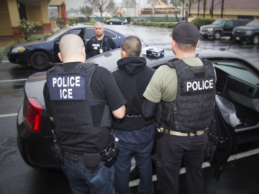 Federal agents arrest a foreign national during an immigration enforcement raid in Los Angeles on Feb. 13.