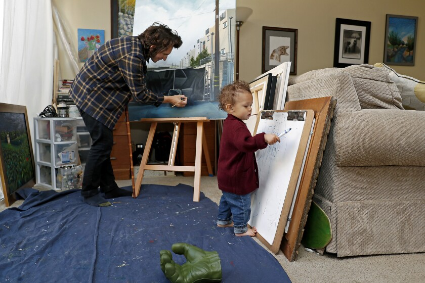 Artist Nico Sauceda and his 18-month-old son, Epic, create art at their home in Huntington Beach.