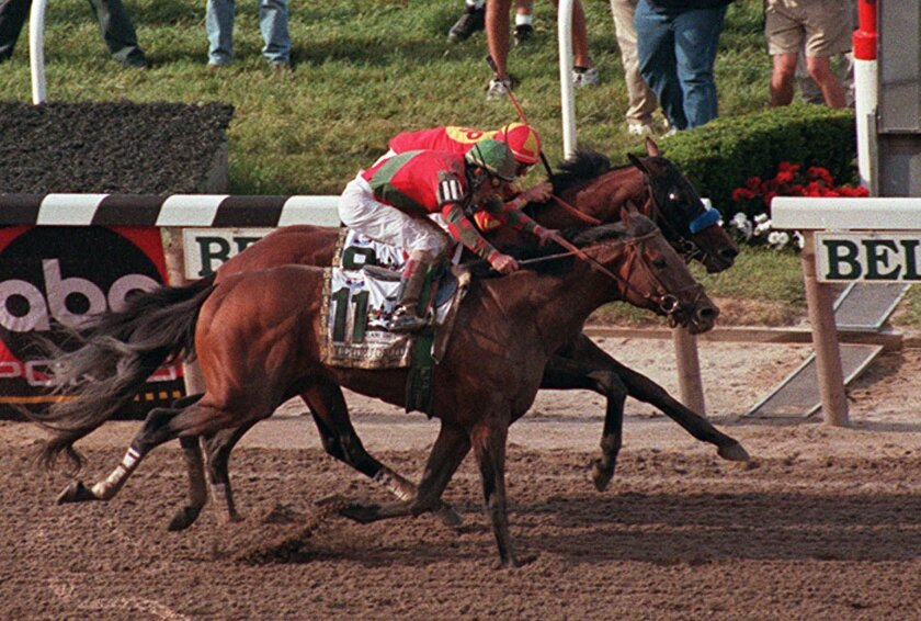 ADVANCE FOR WEEKEND EDITIONS, MAY 30-31 - FILE - In this June 6, 1998, file photo, Victory Gallop, with Gary Stevens up, (11) foreground, edges out Real Quiet, with Kent Desormeaux up, as they cross the finish line in the 130th running of the Belmont Stakes horse race at Belmont Park in Elmont, N.Y. A year after trainer Bob Baffert was beaten in the shadow of the wire, it got worse. Desormeaux was criticized for making his move too early, and by the time Real Quiet was a furlong from the finish, he began staggering home. Victory Gallop bore down and the two hit the wire together. Several agonizing minutes later, the photo went against Real Quiet. AP Photo/Bill Kostroun, File)
