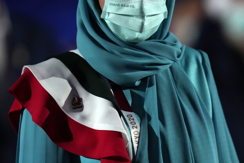 Team member of Iran walks during the opening ceremony in the Olympic Stadium at the 2020 Summer Olympics, Friday, July 23, 2021, in Tokyo, Japan. (AP Photo/Petr David Josek)