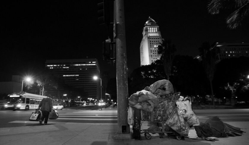 Sleeping in the shadow of City Hall.