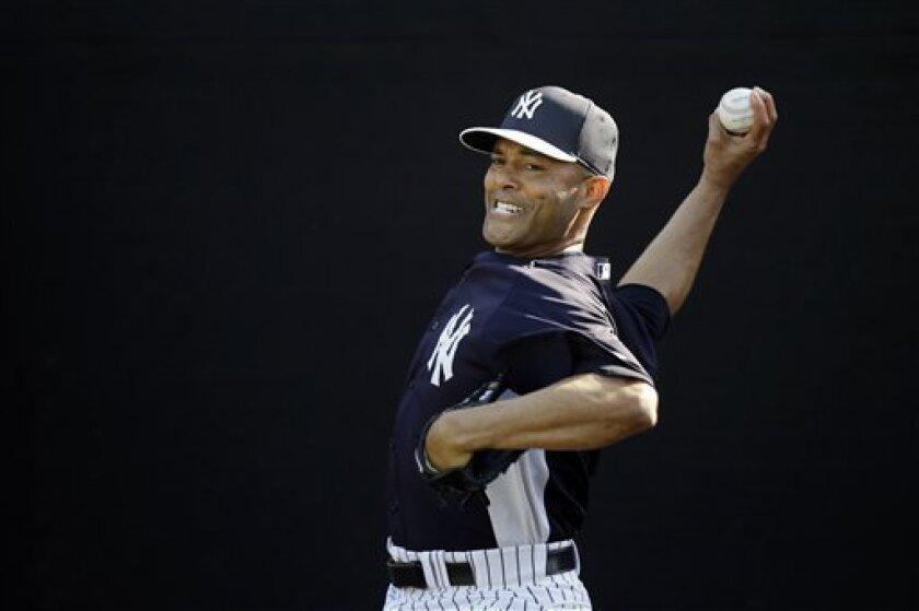 New York Yankees' Mariano Rivera pitches during a workout at baseball spring training, Saturday, Feb. 16, 2013, in Tampa, Fla. (AP Photo/Matt Slocum)