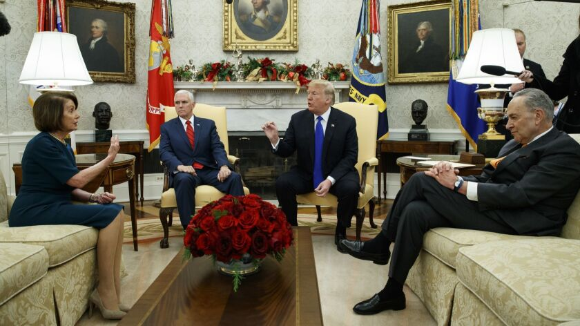 House Minority Leader Rep. Nancy Pelosi, D-Calif., Vice President Mike Pence, President Donald Trump, and Senate Minority Leader Chuck Schumer, D-N.Y., argue during a meeting in the Oval Office in Washington on Dec. 11.