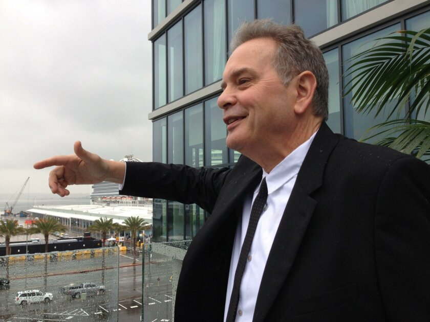 Project architect Gordon Beckman points out the narrow building design for the Lane Field hotels that maximizes views for residents.