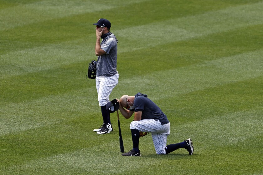 Yankees players react after Masahiro Tanaka was hit by a line drive during a workout July 4, 2020.