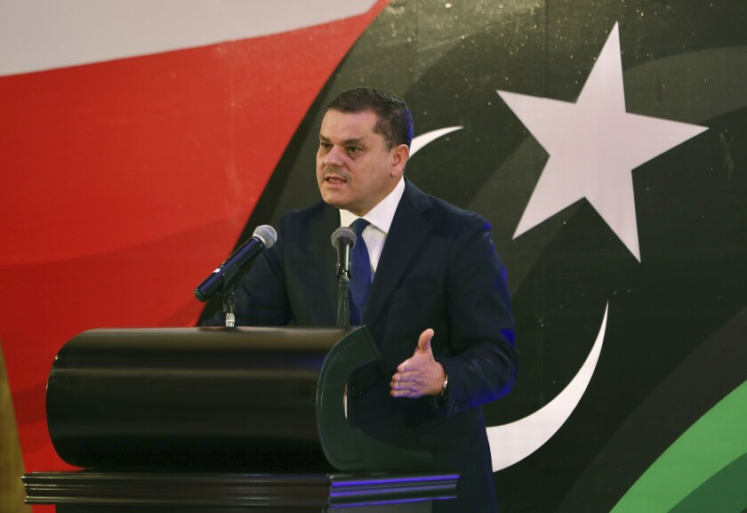 FILE - In this Feb. 25, 2021, file photo, then Libyan Prime Minister-designate Abdul Hamid Mohammed Dbeibah speaks during a news conference in Tripoli, Libya. On Tuesday, Sept. 21,2021, Libyan lawmakers passed a vote of no confidence in the country's transitional government, a move that will throw long-waited elections late this year into further uncertainty. Abdallah Abaihig, a spokesman for the legislature said 113 lawmakers attended the session, with 89 of them voting in favor of withdrawing confidence from the government of Dbeibah. (AP Photo/Hazem Ahmed, File)