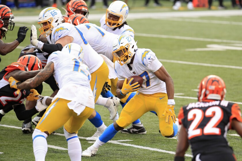 Chargers rookie  Josh Kelley runs for a 5-yard touchdown against the Bengals.