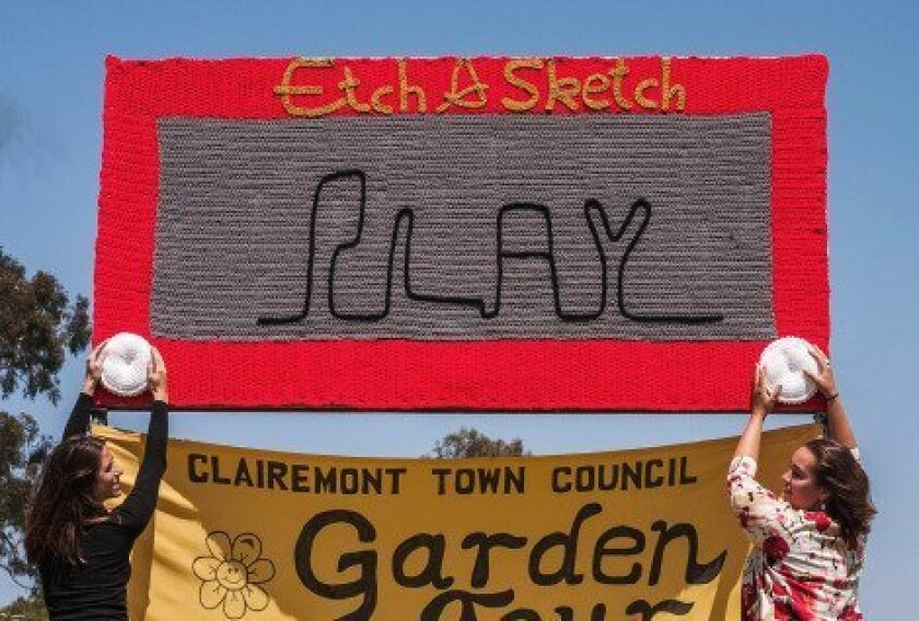 Giant Etch A Sketch yarn art unexpectedly appeared at Clairemont Park & Rec Center last week. Artists Marcy Kraft, left, and Lorna Watt, right, fine tune their creation.