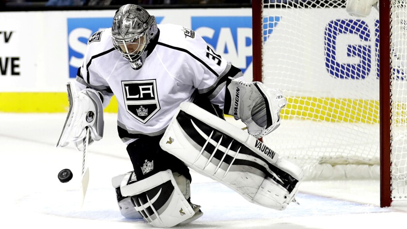 Kings goaltender Jonathan Quick stops a shot by the San Jose Sharks during the first period on Oct. 12.