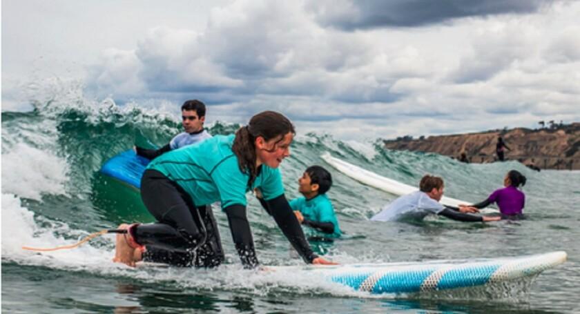Area children learn to surf through the mentorship program ReSurf.