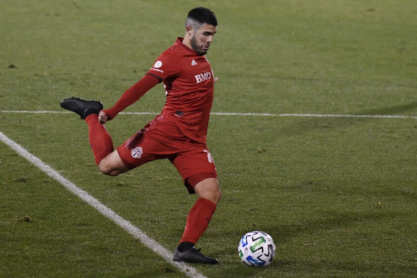Toronto FC's Alejandro Pozuelo takes a shot on goal during overtime of the team's MLS soccer playoff match against Nashville SC, Tuesday, Nov. 24, 2020, in East Hartford, Conn. (AP Photo/Jessica Hill)