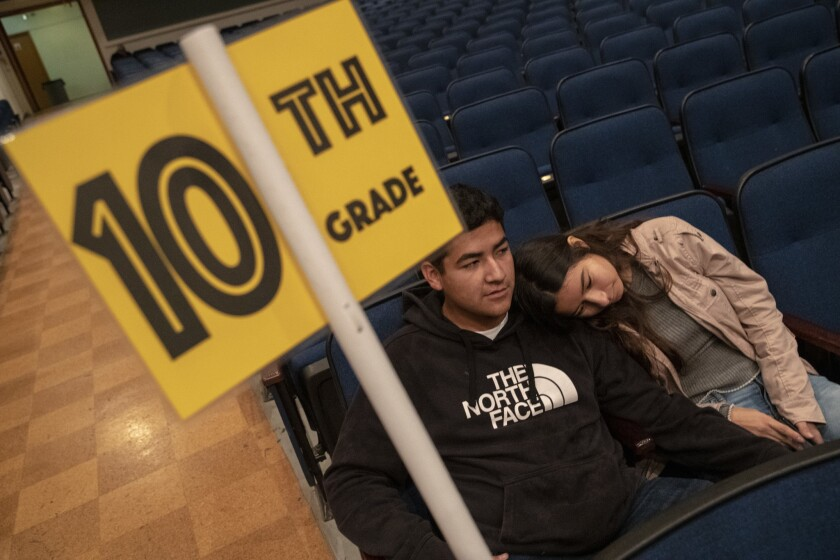 Reseda High students Roosevelt Jimenez, 17, left, and friend Kimberly Aquino, 17, right, sit in the school auditorium as UTLA teachers are out on strike in Reseda.