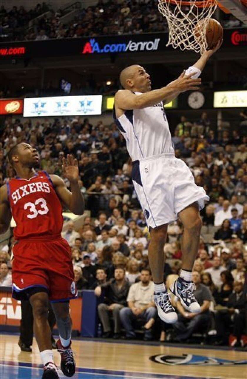 Dallas Mavericks' Jason Kidd, right, shoots on the fast break as Philadelphia 76ers' Willie Green watches in the first half of an NBA basketball game, Monday, Nov. 30, 2009, in Dallas, Texas.  (AP Photo/Mike Stone)