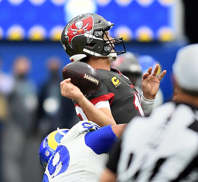 Rams defensive lineman Aaron Donald strips the football from Buccaneers quarterback Tom Brady in the second quarter.