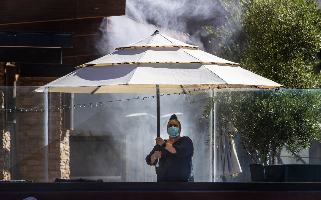Setting up an umbrella for steakhouse dining in Rancho Mirage