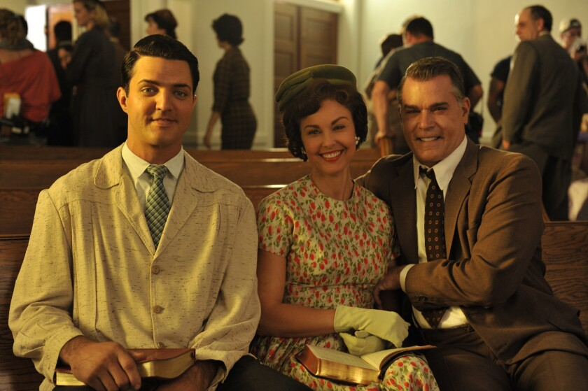 "Blake Rayne, left, Ashley Judd and Ray Liotta in the movie ""The Identical."""