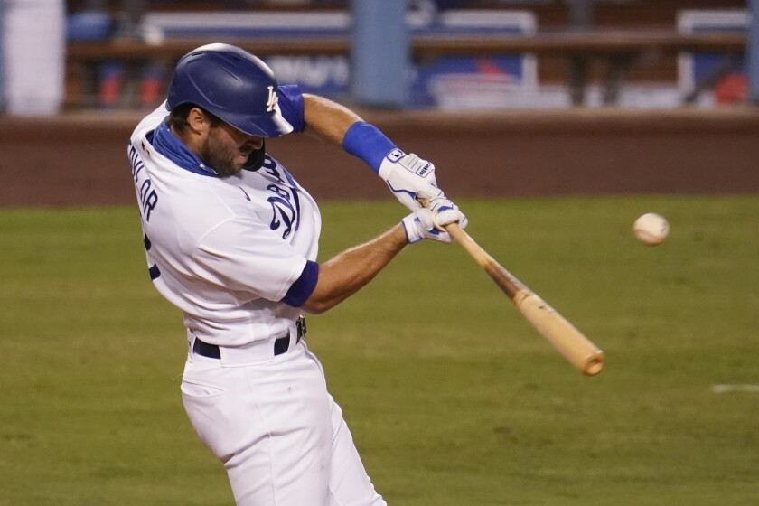 Los Angeles Dodgers' Chris Taylor drives in a run with a double during the third inning of the team's baseball game against the Arizona Diamondbacks on Tuesday, Sept. 1, 2020, in Los Angeles. (AP Photo/Marcio Jose Sanchez)