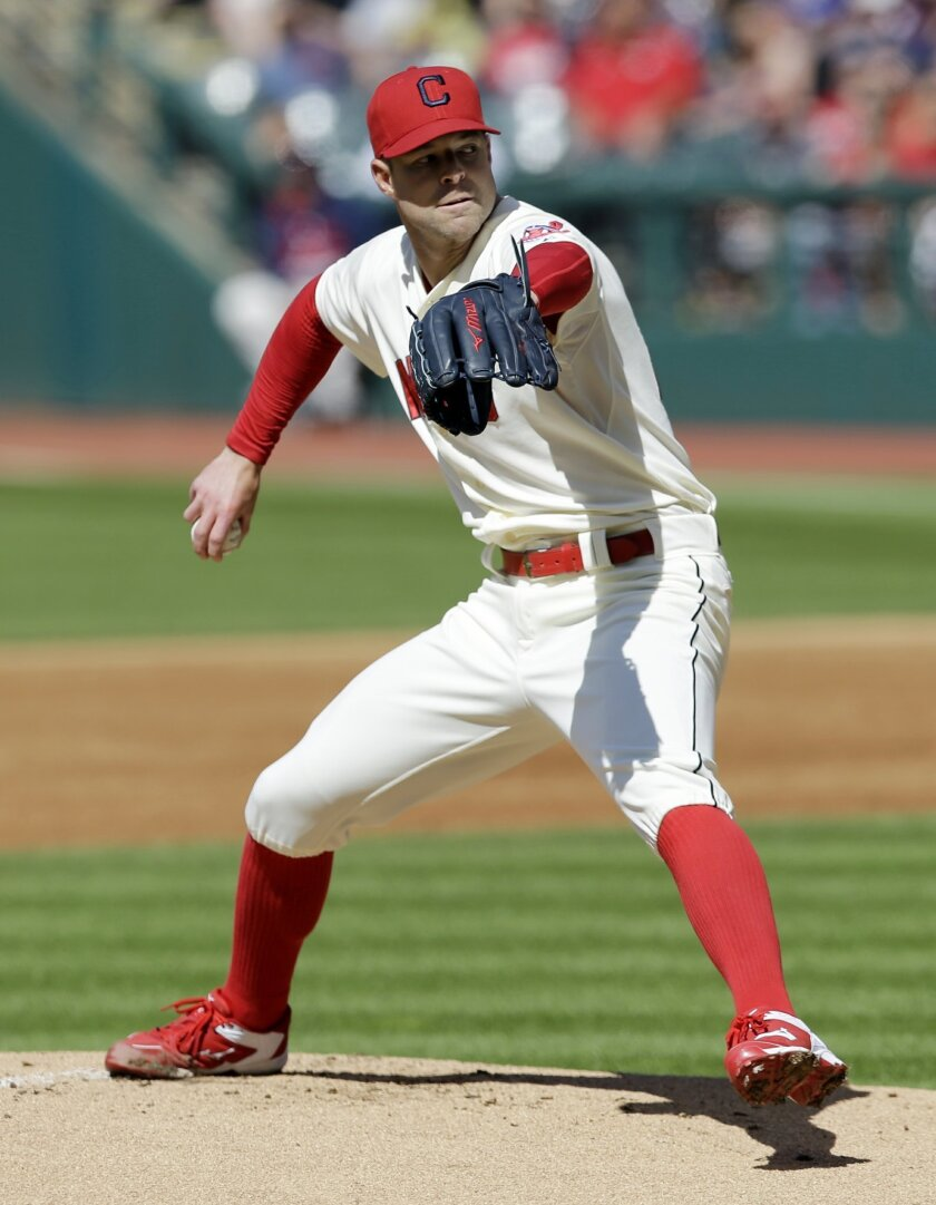 Cleveland Indians starting pitcher Corey Kluber delivers in the first inning of a baseball game against the Cincinnati Reds, Saturday, May 23, 2015, in Cleveland. (AP Photo/Tony Dejak)