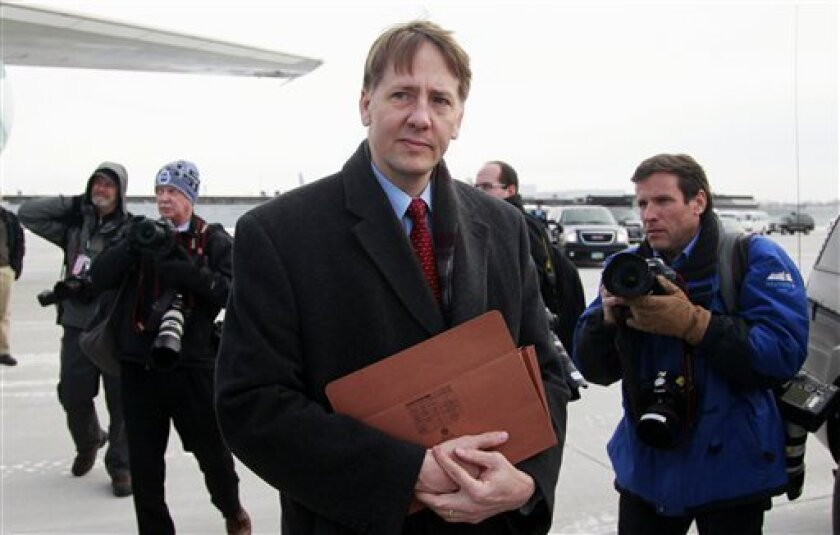 In this Jan. 4, 2012 photo, former Ohio Attorney General Richard Cordray is photographed by the media in Cleveland. Cordray is the first director of the Consumer Financial Protection Bureau (CFPB). Cordray's combative tumble onto the national stage as President Barack Obama's new consumer watchdog has been anything but typical for the studious, mild-mannered public servant who has occasionally been spotted padding around his office in sock feet. (AP Photo/Haraz N. Ghanbari)