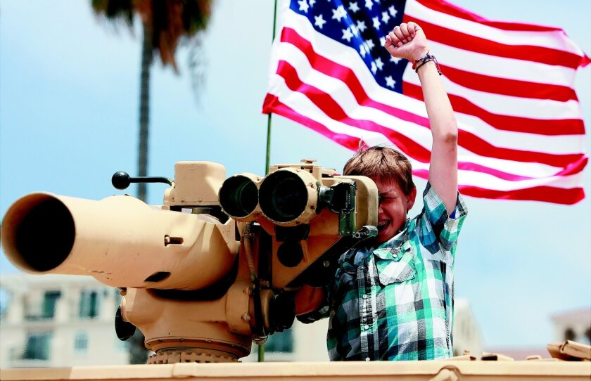 Josh Kirkman raises his arm in triumph after shooting an ememy boat in 2013 during the Oceanside Chamber of Commerce's Operation Appreciation for active-duty military & dependents.