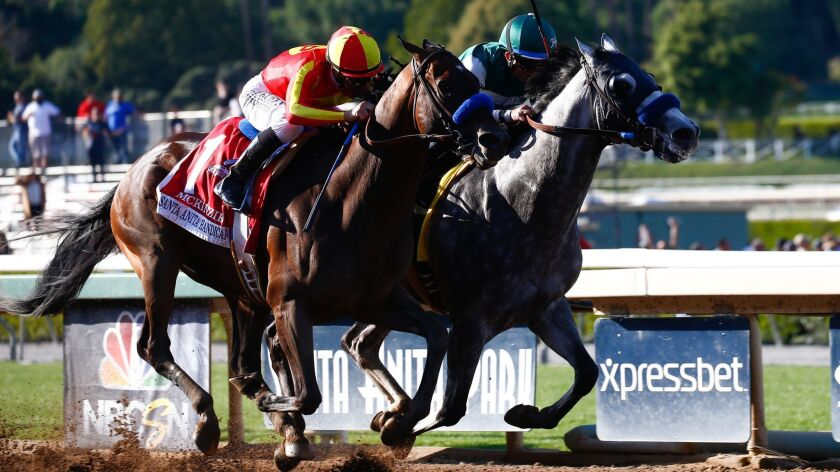 ARCADIA, CALIF. - APRIL 06: McKinzie (1) ridden by jockey Mike Smith, and Gift Box (4) ridden by joc
