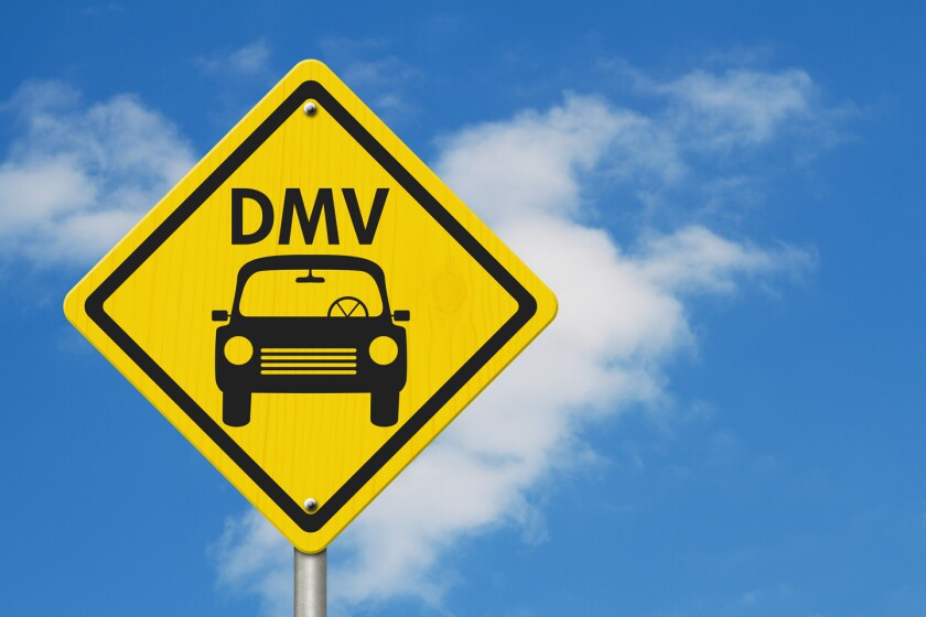 Visit to the DMV Highway Warning Sign, Icon of a car and text DMV on a yellow highway sign with sky background