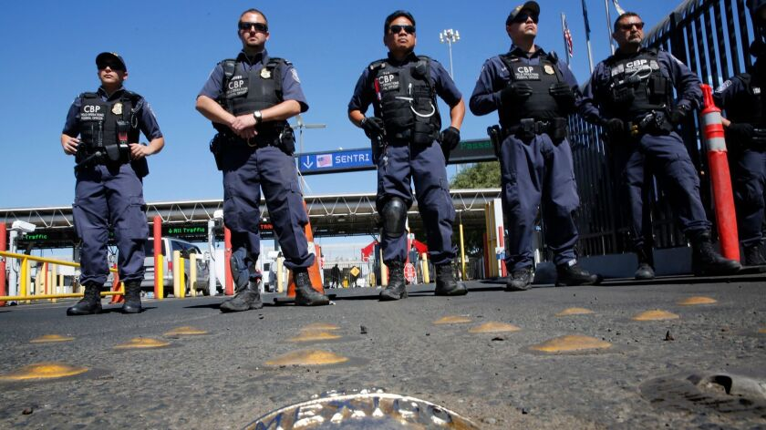 MARCH 10, 2014. TIJUANA, MEXICO. United States Customs and Border Protection officers span the nort