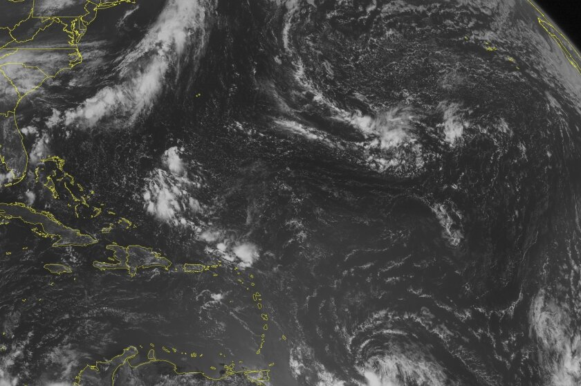 This NOAA satellite image taken Thursday, July 31, 2014 at 10:45 AM EDT shows widely scattered clouds across the Caribbean Basin. A cluster of clouds is present north of Hispaniola, Puerto Rico, and the Virgin Islands. A tropical wave is struggling to organize well east of the Lesser Antilles as it