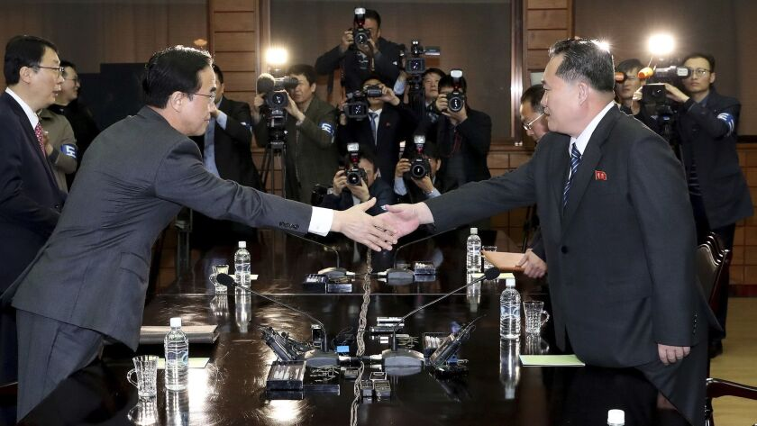 South Korean Unification Minister Cho Myoung-gyon, left, meets North Korean delegation head Ri Son Gwon on Thursday before their meeting in Panmunjom.