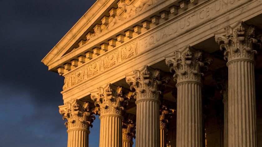 FILE - In this Oct. 10, 2017, file photo, the Supreme Court in Washington is seen at sunset. A flood