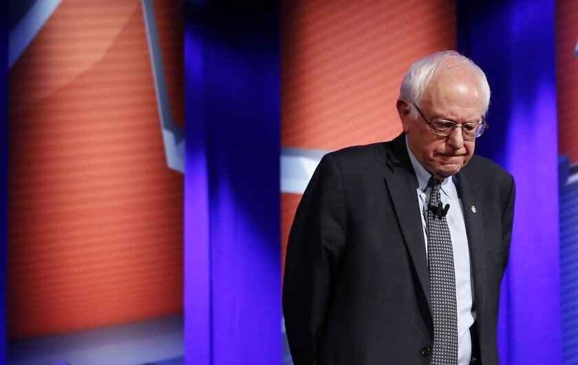 Democratic presidential candidate, Sen. Bernie Sanders, I-Vt., stands onstage during a commercial break during a CNN town hall at Drake University in Des Moines, Iowa, Monday, Jan. 25, 2016. (AP Photo/Patrick Semansky)