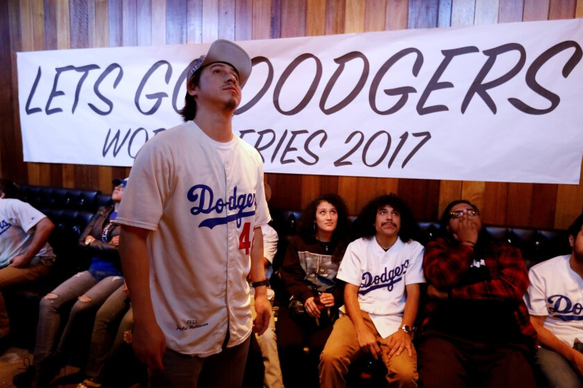 Mescal Miranda, left, of Los Angeles and other fans watch Game 7 of the 2017 World Series. The Dodgers lost the game to the Houston Astros, 5-1, and the Series.