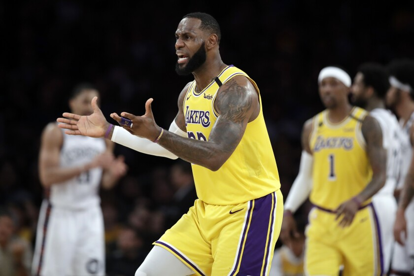 Los Angeles Lakers' LeBron James argues a call during the second half of an NBA basketball game against the Brooklyn Nets Tuesday, March 10, 2020, in Los Angeles. (AP Photo/Marcio Jose Sanchez)