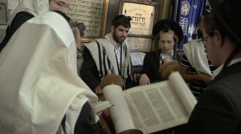 """Orthodox Jews in a synagogue in Israel in """"Colliding Dreams."""""""