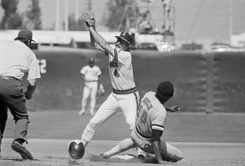 Angels second baseman Bobby Grich catches a throw in front of Baltimore Orioles baserunner Pat Kelly during a game in 1979.