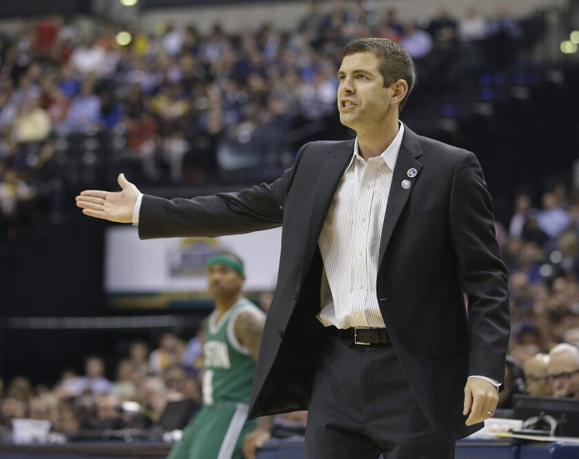 Boston Celtics head coach Brad Stevens argues a call during the first half of an NBA basketball game against the Indiana Pacers, Wednesday, Nov. 4, 2015, in Indianapolis. (AP Photo/Darron Cummings)