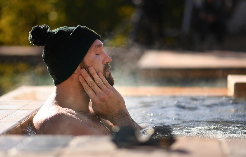 Tyson Fury sits in a jacuzzi after an early morning workout in Las Vegas.