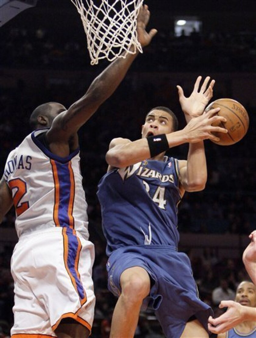 Washington Wizards' JaVale McGee, right, is fouled as he shoots by New York Knicks' Tim Thomas during the second quarter of an NBA basketball game Wednesday, Jan. 14, 2009 at Madison Square Garden in New York. (AP Photo/Julie Jacobson)