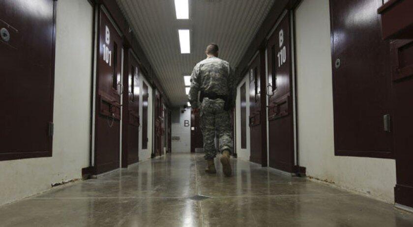 An Army guard walks the hallway in Camp 5 at U.S. Navy base at Guantanamo Bay, Cuba.