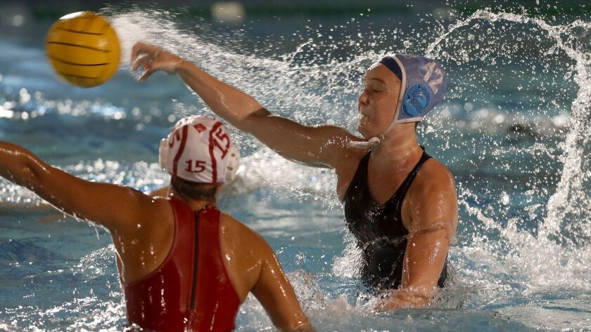 Corona del Mar High's Sophie Wallace (12) fires for the net against Orange Lutheran during the first