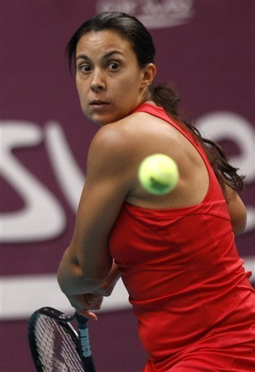 Marion Bartoli of France returns the ball to Klara Zakopalova of the Czech Republic during their semifinal singles match at the GDF Suez WTA Open 2012 tennis tournament at Coubertin stadium in Paris, Saturday, Feb. 11, 2012. Bartoli won 7-6, 6-0. (AP Photo/Michel Euler)