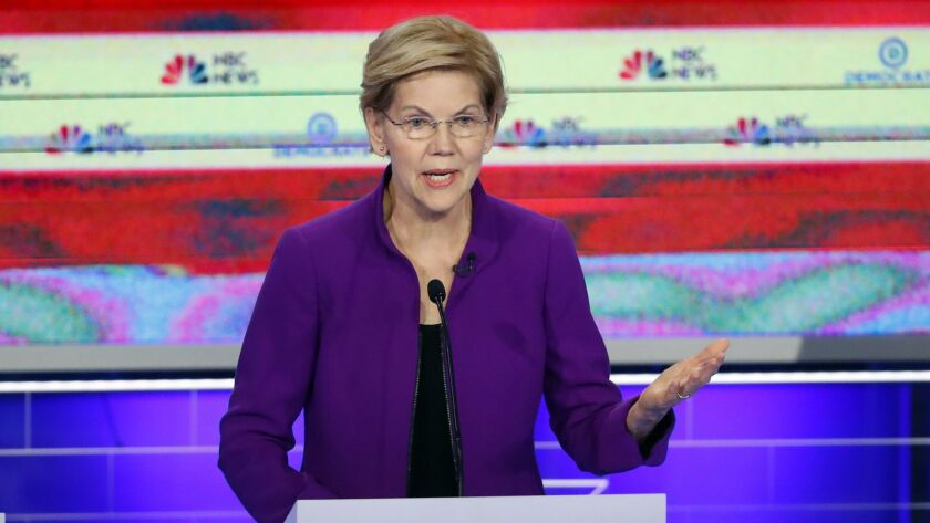 Democratic presidential candidate Sen. Elizabeth Warren (D-Mass.) stood at center stage, but pulled her party to the left during Wednesday night's Democratic debate.