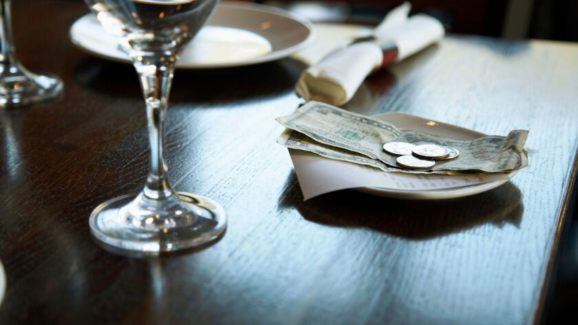 Dollar Bills and Receipt on Restaurant Table. Tip, tipping. Getty Images ** OUTS - ELSENT, FPG, CM